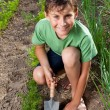 Boy working in the garden — Stock Photo #5798638