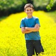 Cute kid in a field of flowers — Stok fotoğraf