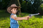 Cute kid playing cowboy — Stock Photo