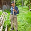Old rural man using scythe — Stock Photo #5859706