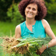 Stock Photo: Young womwith sheaf of dill