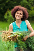 Young woman with a sheaf of dill — Stock Photo