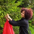 Woman picking fir buds - Stockfoto