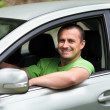 Happy young man with new car — Foto de Stock
