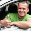 Happy young man with new car - Stockfoto