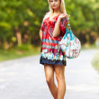 Young blond woman outdoor on a street — Stock Photo #5960246