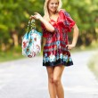 Foto Stock: Young blond woman outdoor on a street