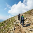 Tourists hiking on Iezer peak in Parang mountains, Romania - Stock Photo