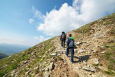 Tourists hiking on Iezer peak in Parang mountains, Romania — Stock Photo