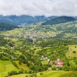 Alpine landscape with houses in Tyrol — Stock Photo #6084754
