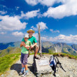 Father and son on Buteanu peak in Romanian mountains - Stock Photo