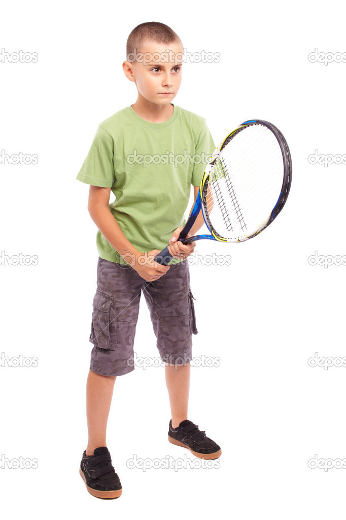 Child playing training with a field tennis raquet, studio full length portrait  Stock Photo #6203510