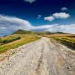 Landscape with dirt road - Stock Photo