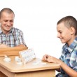 Father and son playing rummy — Stock Photo