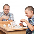 Father and son playing rummy — Stock Photo #6316522