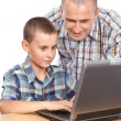 图库照片: Father and son at computer