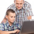 Father and son at the computer — Foto de Stock