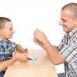 Father and son playing cards — Stock Photo