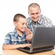 Father and son at the computer — Stock Photo #6316534