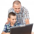 Father and son at the computer — Stock Photo #6316538