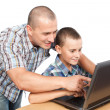 Father and son at the computer — Stock Photo #6316539