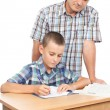 Father verifying son's homework - Foto de Stock