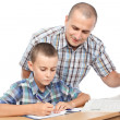 Foto Stock: Father verifying son's homework