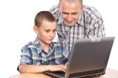 Father and son at the computer — Stock Photo
