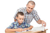 Father verifying son's homework — Stock Photo