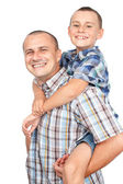Father and son piggyback — Stock Photo
