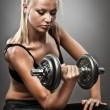 Young athletic woman doing workout — Foto Stock #6467152