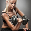 Young athletic woman doing workout - Stock Photo