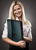 Attractive businesswoman with folder — Stock Photo