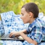 Boy using laptop outdoor — Stock Photo #6588453
