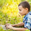 Royalty-Free Stock Photo: Boy using laptop outdoor