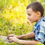 Boy using laptop outdoor — Stock Photo #6588458