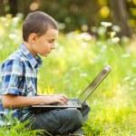 Boy using laptop outdoor — Stock Photo #6588462