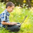 Boy using laptop outdoor — Stock Photo #6588463