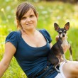 Young woman and her chihuahua dog — Stock Photo