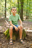 Boy outdoor in the forest — Stock Photo