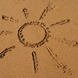 The sun drawn in the sand — Stock Photo