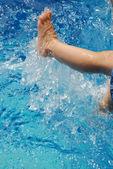 Little legs splashing water — Stock Photo