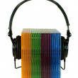 Cd cases and headphones — Stock Photo