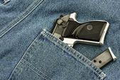Pocket pistol and magazine — Stock Photo