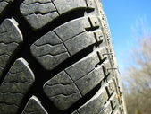 Close-up of a tire with sky background — Stock Photo