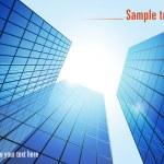 Blue glass modern buildings — Stock Vector #5655228