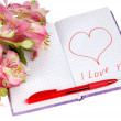 Notebook with flowers by a heart and inscription — Stock Photo