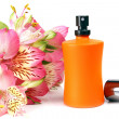 Small bottle with a perfume liquid and flowers — Stock Photo