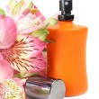 Small bottle with a perfume liquid and flowers — Stock Photo #5750786