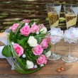 Stock Photo: Wedding bouquet is glasses and rings